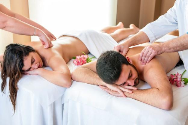Couple Enjoying Body Massage In Spa.